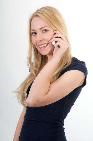 Teenage talking on the phone with white background photo