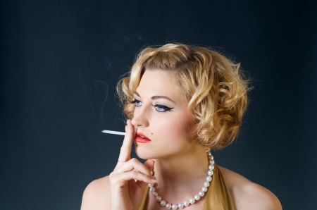 beautiful blond woman smoking cigarette photo
