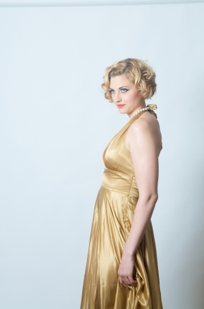 beautiful blond woman in gold dress photo