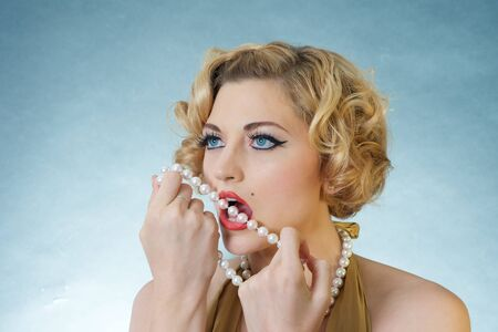 monroe: beautiful blond woman with pearls, marilyn monroe style Stock Photo