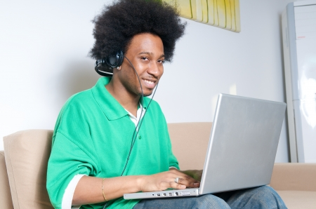 African American listen music with latop in livingroom Stock Photo - 15244327