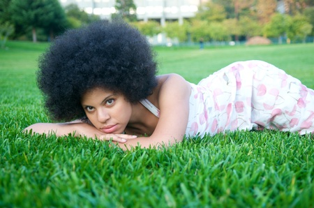 Portrait of beautiful african american model with afro look in nature