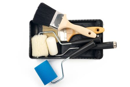 painting and decorating: Paint rollers and brush on black tray Stock Photo