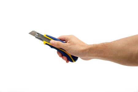 Hand holding box cutter on white background