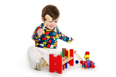 Baby toddler child playing with wooden toys