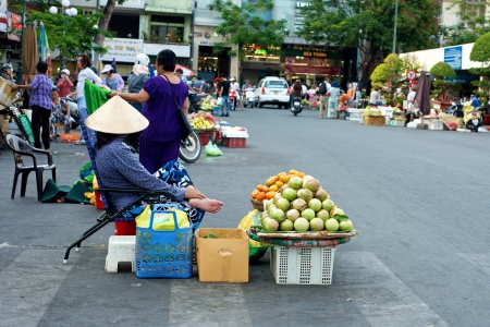 Street vendors selling fruit on the streets of Ho Chi Minh City in Vietnam