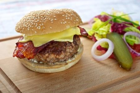 Fresh delicious Cheese Hamburger on cutting board photo