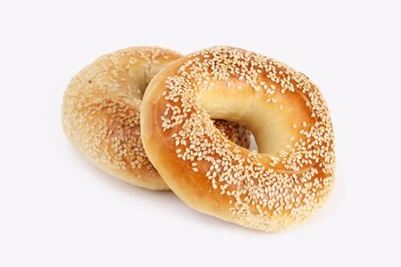 bagel: two sesame Bagels on white  Stock Photo
