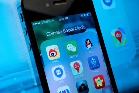 Shanghai, China - December 30, 2013: Emergence of Chinese Social Media and the rise of WeChat from Tencent in competing with Facebook.  Stock fotó - 25982140