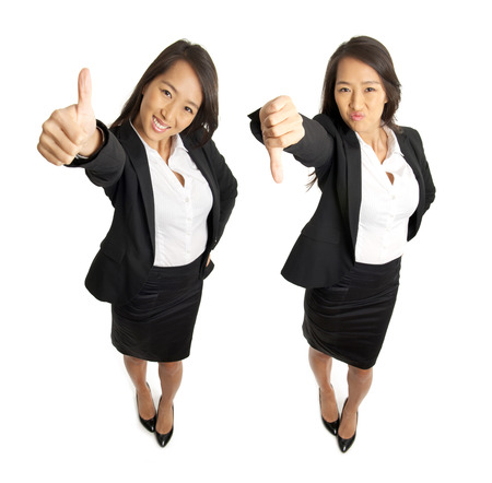 thumb's up: Smiling and angry business woman with thumbs up and thumbs down Stock Photo