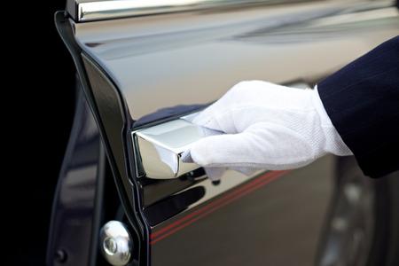 opens: Chauffeur opens car door
