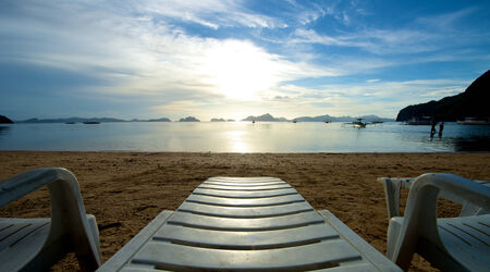 El Nido beach with recliner in the Palawan Island in the Philippines. photo
