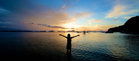 Girl with arms wide open in El Nido in the Philippines. photo