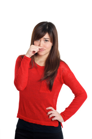smelly: Girl in red with smelly gesture  on white background Stock Photo