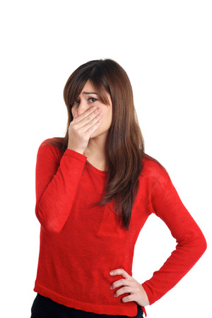 unpleasant: Girl in red with smelly gesture  on white background Stock Photo