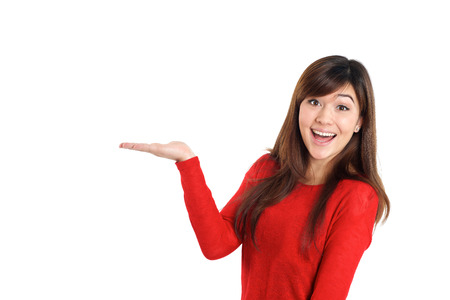 Surprised woman holding product on white background 스톡 콘텐츠