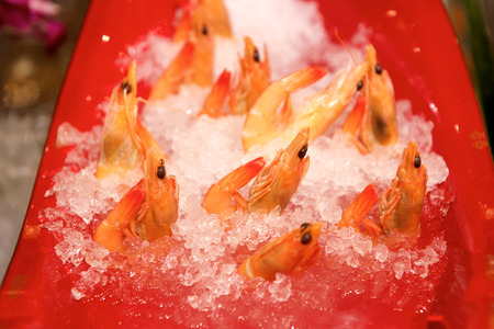 luxuries: Shrimps on ice in a buffet restaurant Stock Photo