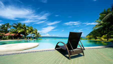 recliner: Swimming pool vacation resort with recliner in Boracay Island in the Philippines.