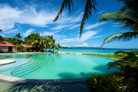 Swimming pool resort vacation on Boracay Island in the Philippines. Stock Photo
