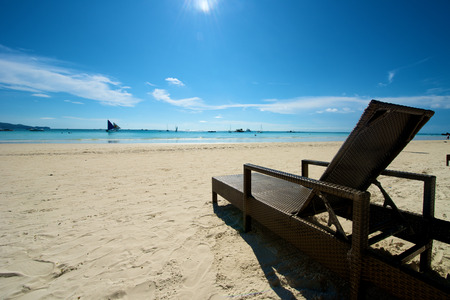 recliner: Beach view with recliner in Boracay Island in the Philippines.