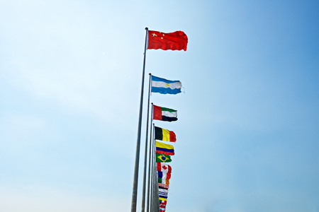rise: A row of flags with Chinese flag leading other nation. Rise of China Stock Photo