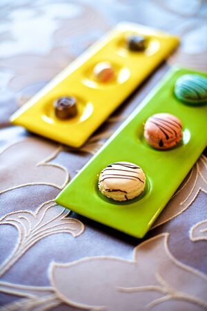 macarons: Colorful macarons served in bed.