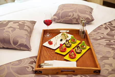 appetizers: Canapé appetizer in bed in luxury hotel