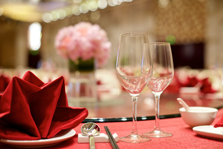 restaurant setting: Chinese Wedding table set up with wine glasses