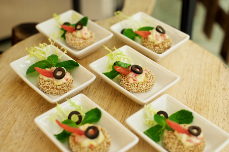 garnish: Delicious Canapés starters on plate in restaurant Stock Photo