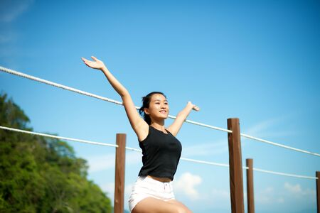arms wide open: girl relax with arms wide open in the nature Stock Photo