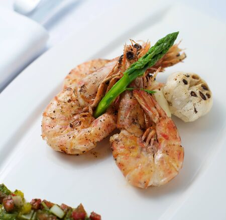 diet dinner: Cooked Shrimp with asparagus and garlic on plate