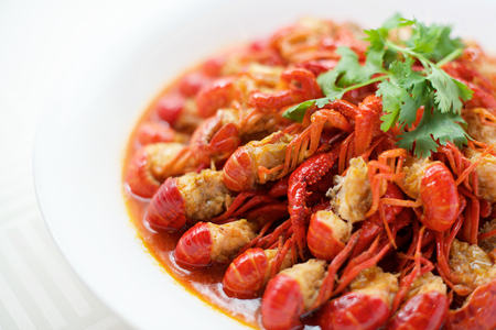 diet dinner: Spicy Chinese crayfish dish on white plate Stock Photo
