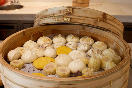 Assorted Chinese buns in large bamboo steamer