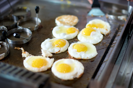 sunny side: Sunny side up eggs on a grill in restaurant Stock Photo