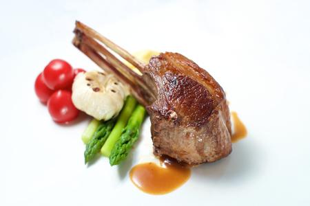 Lamb chop dish on a white plate Banco de Imagens