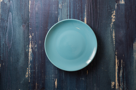 Blue Round Plate on ocean blue wooden table background