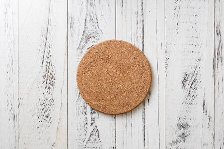 Cork Coaster on white wooden table background Stock fotó
