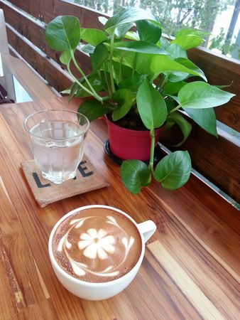 caffe: Relax with a cup of coffee with lovely flower caffe latte art