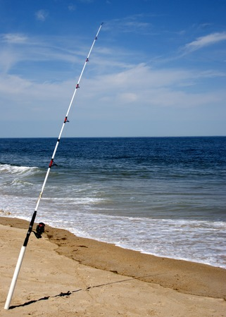 sea waves: Fishing pole with Sea Waves in the Atlantic Ocean Stock Photo