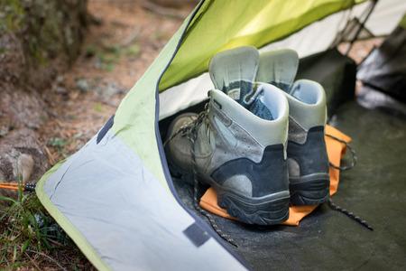 Trekking shoes in a tent 免版税图像