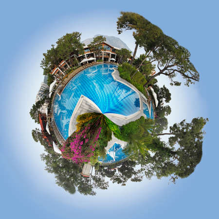 circumference: 360 degree view of hotel pool around the circumference of a watery planet with reflections and trees, floating in a blue sky