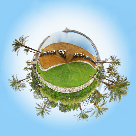 circumference: 360 degree view of grass and sea the circumference and trees in a blue sky