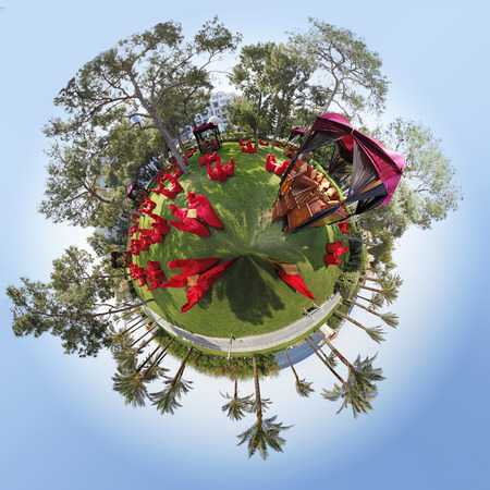 circumference: 360 degree view of grass the circumference and trees in a blue sky