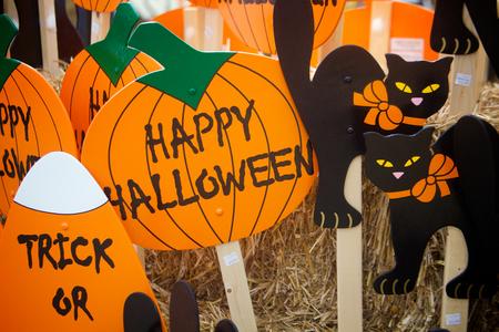 Halloween decorative pumpkins, candy corn and black cats