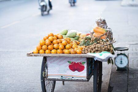 seller: street seller of seasonal fruit
