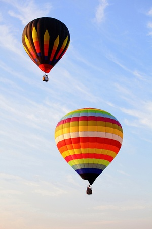 hopper: There are two colorful hot air balloons with the blue sky at Thailand Balloon festival 2010