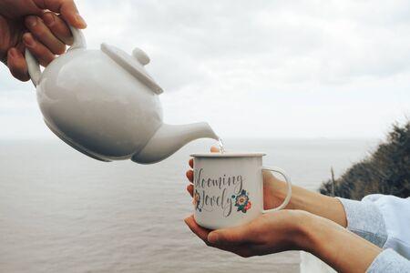 Tea in the morning. Breakfast tea. Vocation on the seaside. Drinking tea in nature.