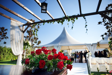 beautiful ceremony venue with flowers and blue sky photo