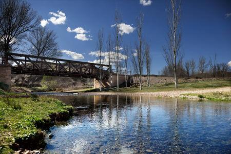 Beautiful river landscape with railroad iron bridge