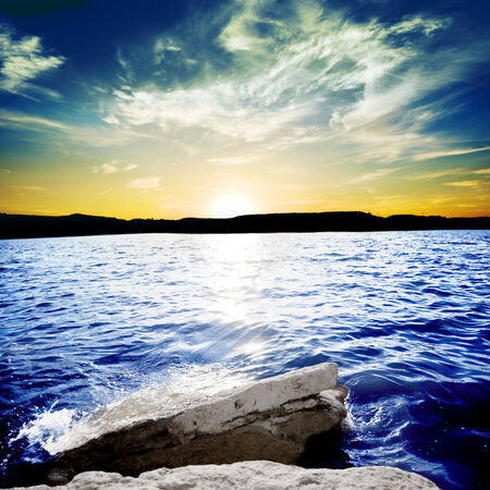 Ocean waves breaking on a rock with sunset. beautiful landscape of sunset with ocean waves breaking on a rock